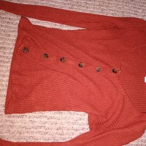 Reddish orange long sleeve shirt